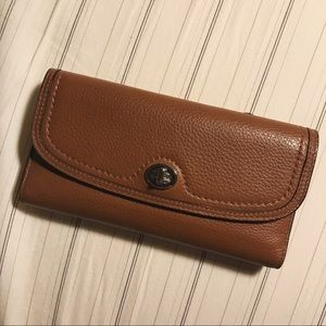 Pebbled brown Coach wallet and check book